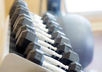 Workout dumbbells at The Pointe at Crestmont gym